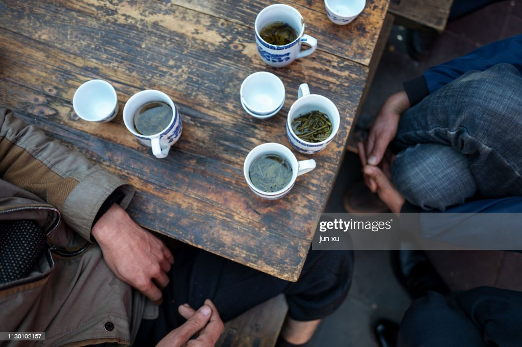 Playing CARDS and drinking tea in a teahouse : Stock Photo