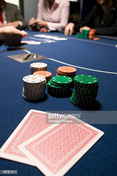 Playing cards and stacks of gambling chips on casino table