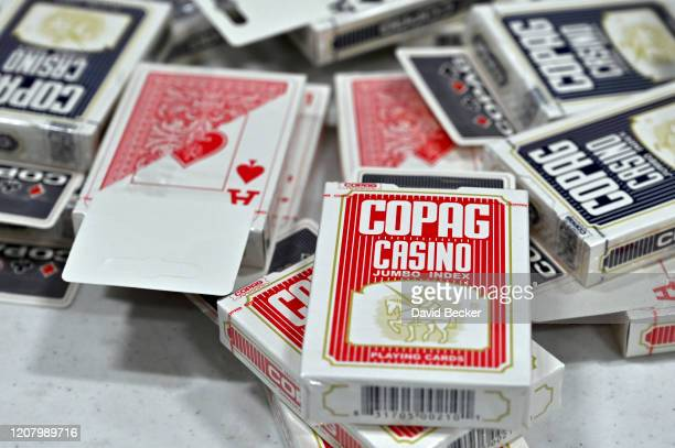 Playing cards are stacked on a table ready to be used in the event of a tie during the Nevada Democratic Caucus at Centennial High School on February...