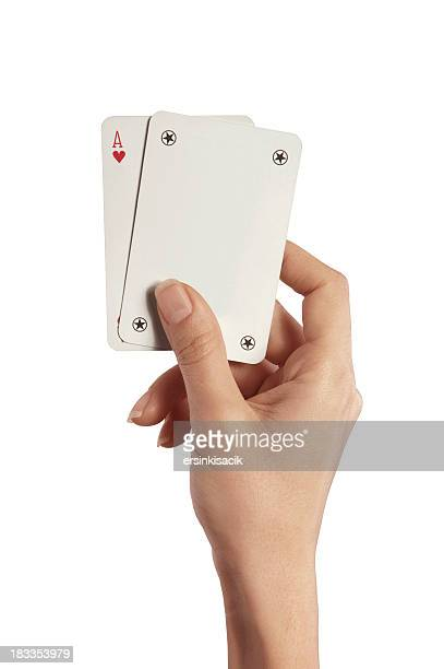 playing cards in woman hand (ace and joker) - joker card stock photos and pictures