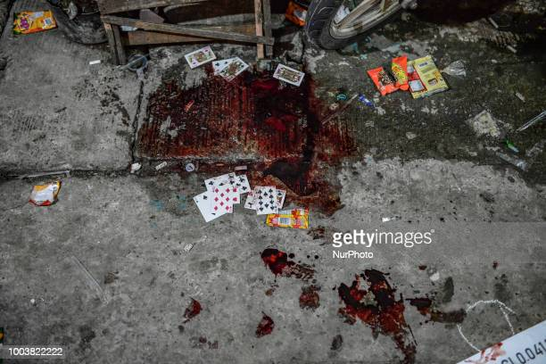 Playing cards is seen soaked in blood belonging to a suspected drug pusher who was killed by unknown assailants in Navotas Metro Manila Philippines...