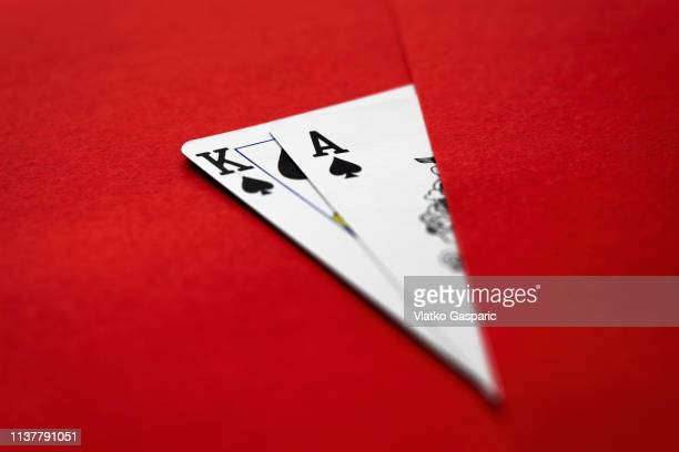 playing cards, king and ace on red surface - texas hold 'em stock pictures, royalty-free photos & images