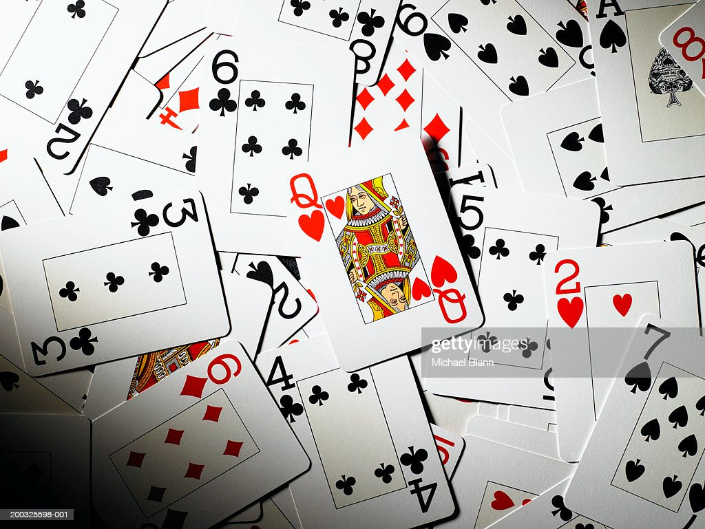 Playing cards mixed together, queen of hearts in centre : Stock Photo