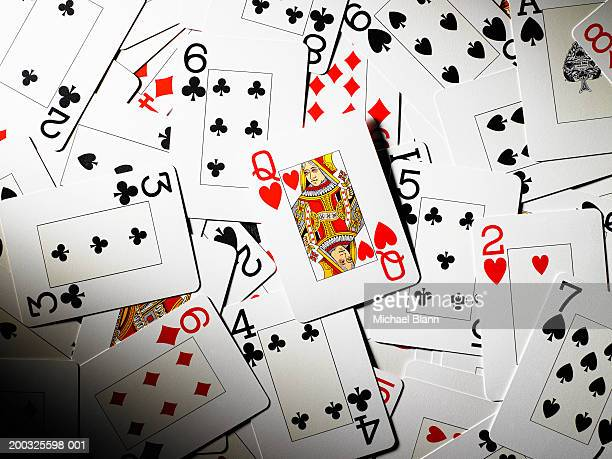 playing cards mixed together, queen of hearts in centre - queen of hearts stock photos and pictures