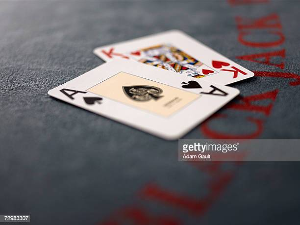 Playing cards on Blackjack table in casino, close-up