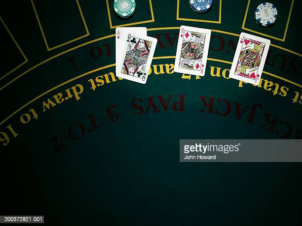 Playing cards on gaming table, overhead view