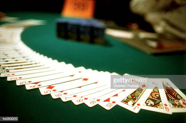 playing cards spread out across a casino table