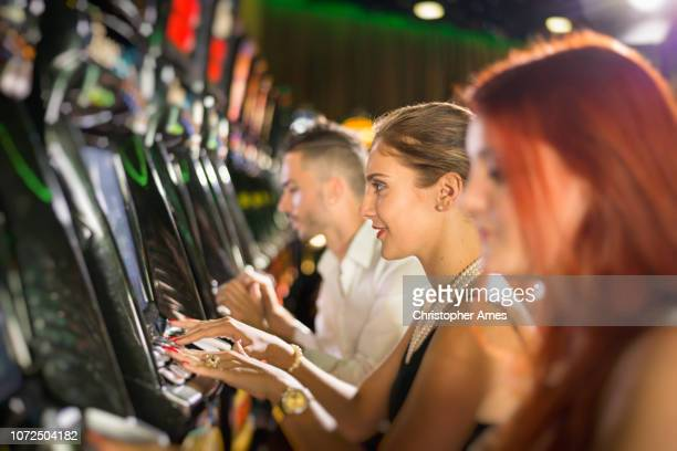 playing casino slot machines - gambling addiction stock pictures, royalty-free photos & images