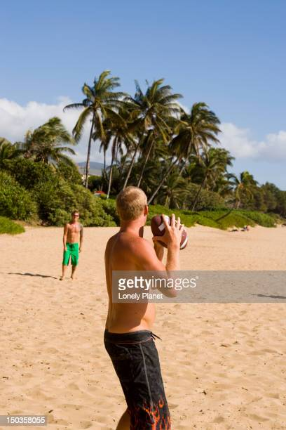 Playing catch on Charley Young Beach, Kihei, South West Maui.