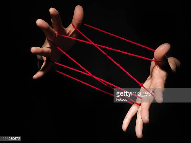 Playing cats cradle game.