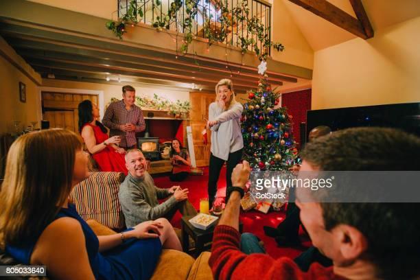 Playing Charades at a Christmas Party