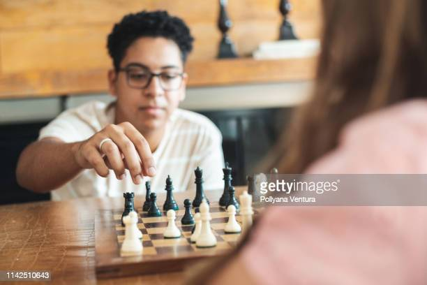 playing chess at home - chess stock pictures, royalty-free photos & images