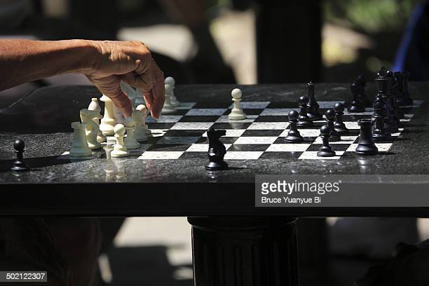 playing chess at washington square - washington square park stock pictures, royalty-free photos & images