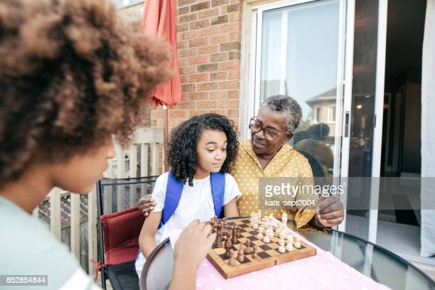 Playing chess with grandmother