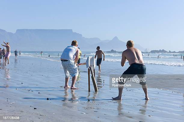 Playing Cricket on Bloubergstrand, Cape Town, South Africa.