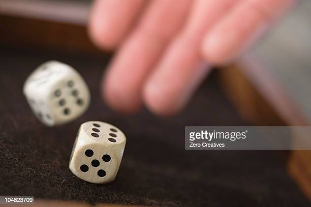 playing dice - rolling stock pictures, royalty-free photos & images