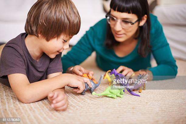 Playing dinosaurs with mom