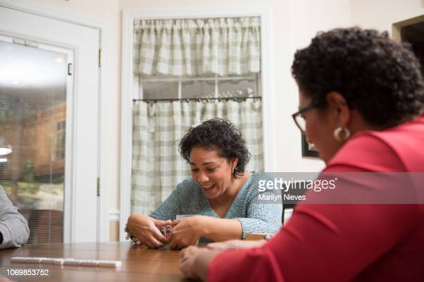 """playing dominoes - """"marilyn nieves"""" stock pictures, royalty-free photos & images"""
