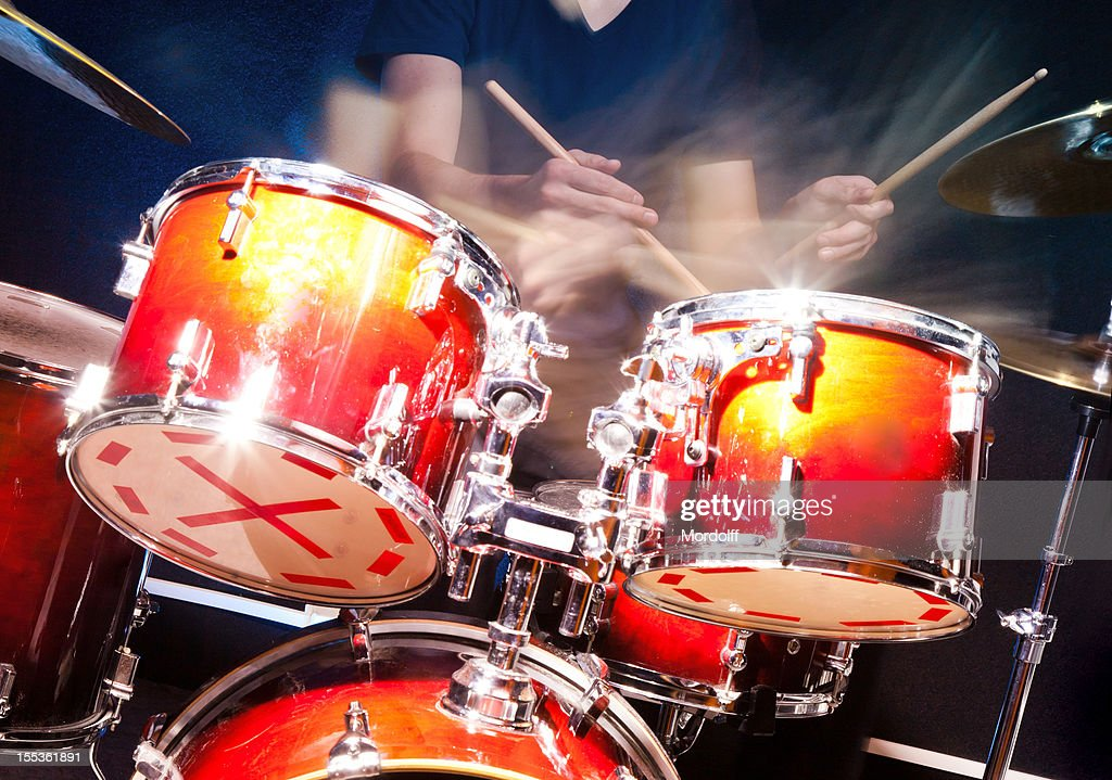 Playing drums action : Stock Photo
