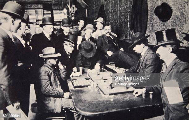 Playing Faro in the Orient Saloon Bisbee Arizona USA 1903 The man in the silk hat is Smiley Lewis while John Murphy is dealing The town of Bisbee...