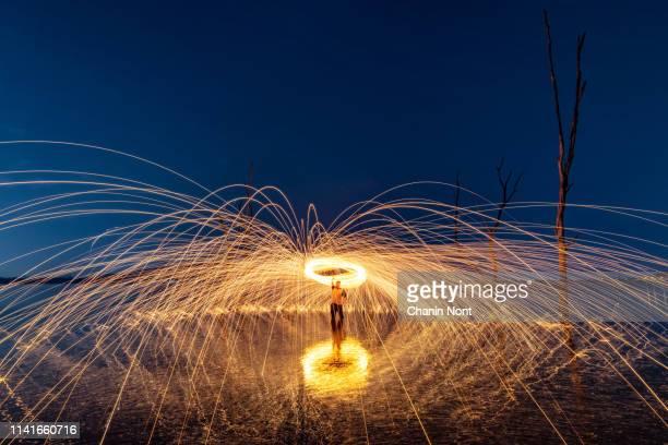 playing fireworks by spinning light painting at night - arte, cultura e espetáculo imagens e fotografias de stock