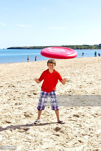 Playing flying disc on a beach