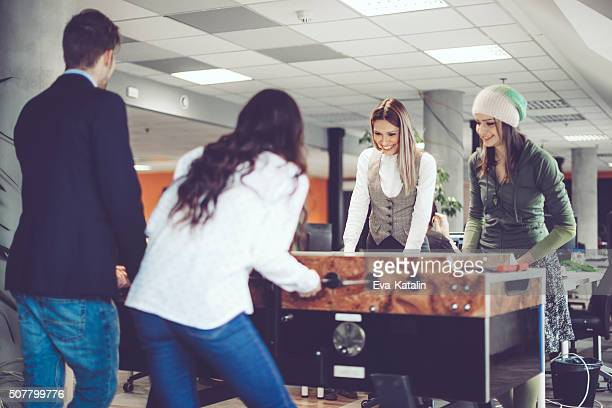 Playing foosball at work