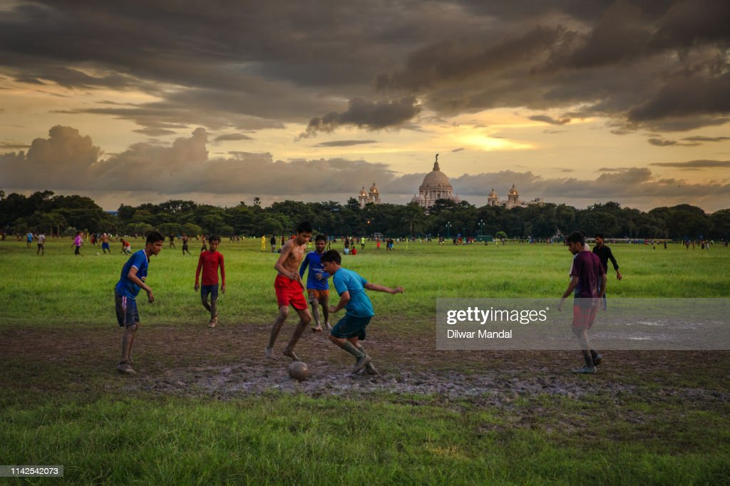 Playing football at Maidan : Stock Photo