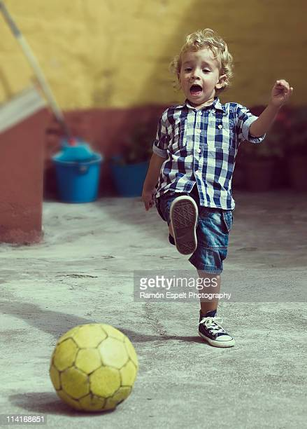 playing football - kicking stock pictures, royalty-free photos & images