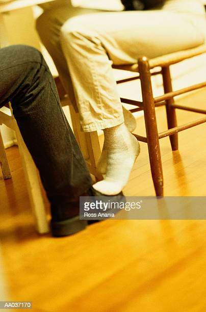 playing footsie - playing footsie stock pictures, royalty-free photos & images