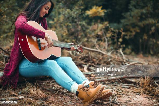 playing for her own - classical guitar stock photos and pictures