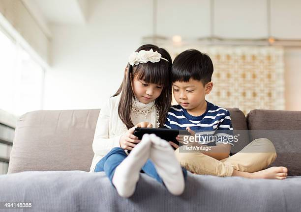 playing games - digital native stock photos and pictures