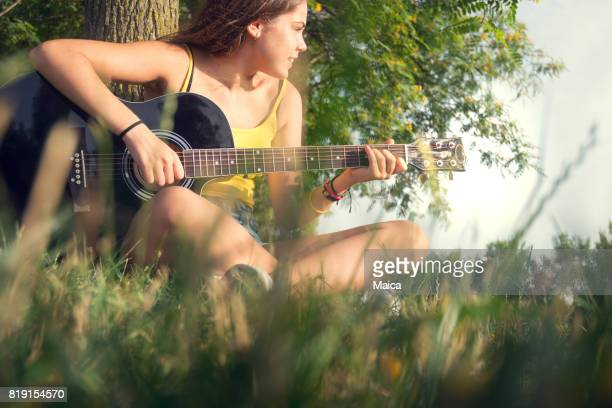 Playing guitar at sunset