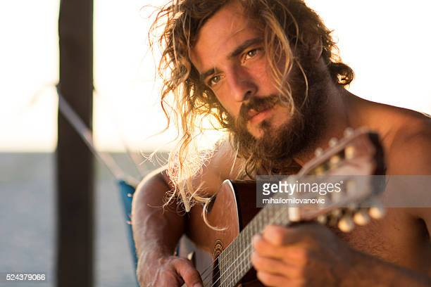 Playing guitar at the beach