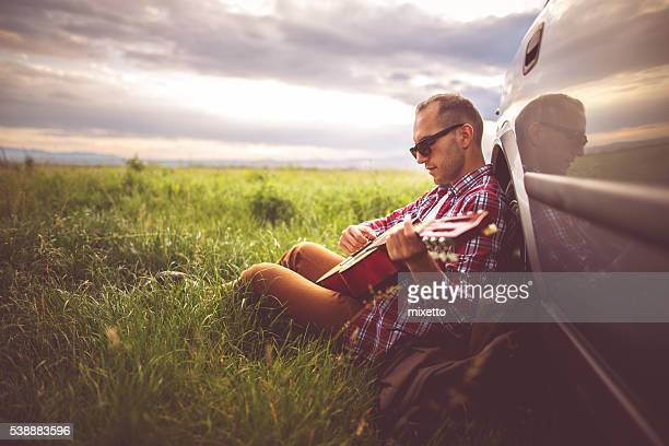 playing guitar in nature - folk stock photos and pictures