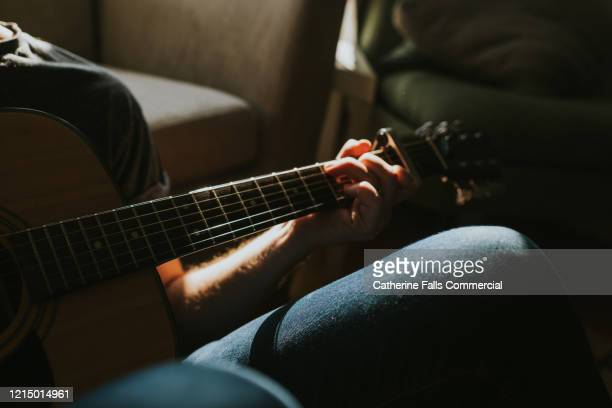 playing guitar - songwriter stock pictures, royalty-free photos & images