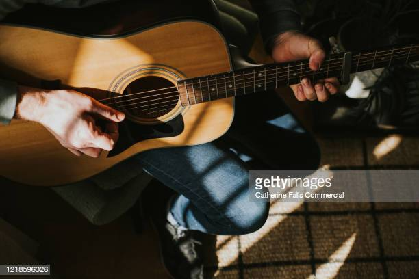 playing guitar - musician stock pictures, royalty-free photos & images
