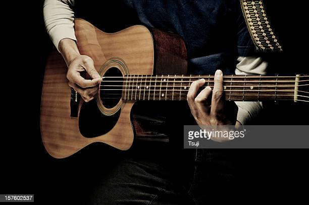 playing guitar - acoustic guitar stock pictures, royalty-free photos & images