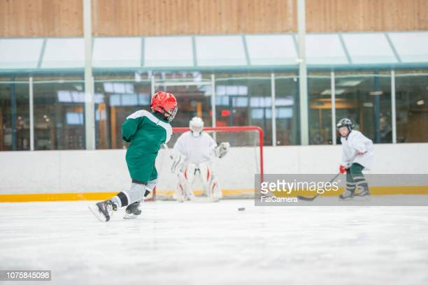 playing hockey together - fat goalkeeper stock pictures, royalty-free photos & images