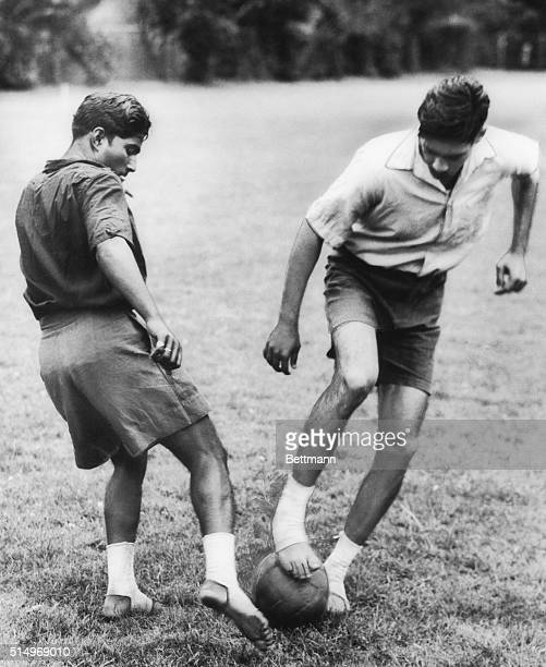 Playing in bare feet two members of India's Olympic football team practice at the Imber Court Sports Club for their match on July 16th 1948 with the...