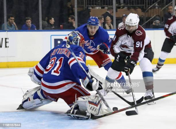 Playing in his first NHL game Igor Shesterkin of the New York Rangers makes the third period save on Nazem Kadri of the Colorado Avalanche at Madison...