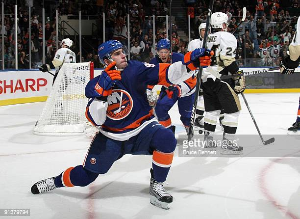 Playing in his first NHL game John Tavares of the New York Islanders celebrates after scoring his first NHL goal against the Pittsburgh Penguins at...