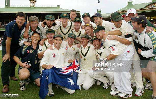 Playing in his last match, Australian captain Steve Waugh poses with his team after drawing their Test Match against India on the final day of the...