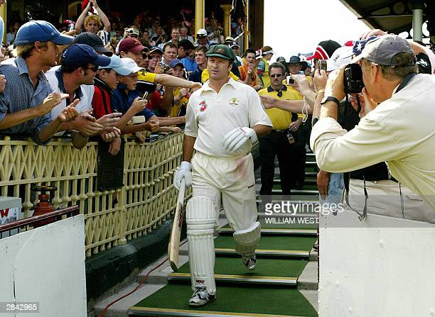 Playing in his last Test Match Australian captain Steve Waugh comes out to bat on the third day of the fourth Test Match in Sydney 04 January 2004...