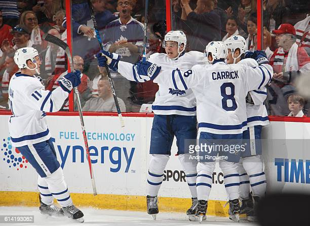 Playing in his NHL debut Auston Matthews of the Toronto Maple Leafs celebrates his second career NHL goal against the Ottawa Senators with teammates...