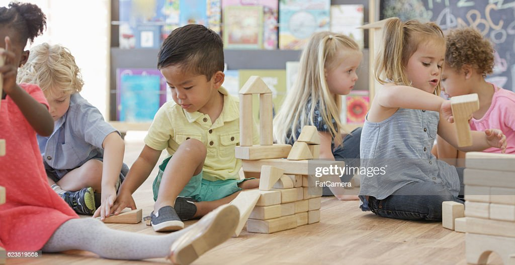 Playing in Preschool Together : Stock Photo