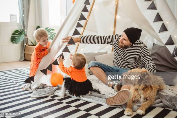 playing in tent for halloween - domestic animals stock pictures, royalty-free photos & images