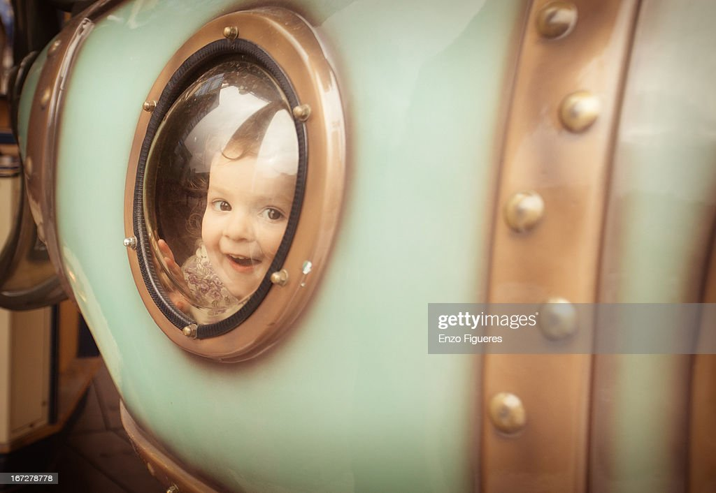 Playing in the carrousel : Stock Photo
