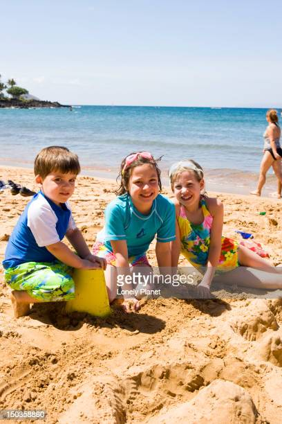 Playing in the sand at Ulua Beach, South West Maui.