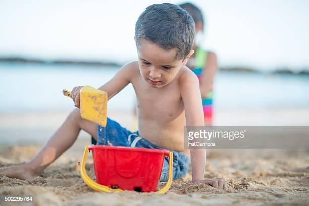 Playing in the Sand on a Hawaiian Beach